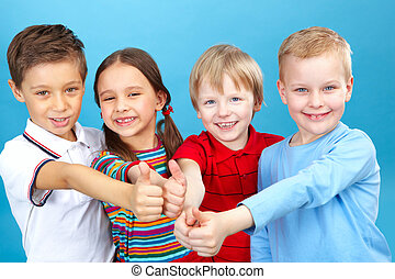 Thumbs up! - Four kids with their thumbs up looking at...