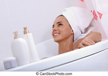 Bathtub relax - Tilt up of attractive girl with towel on her...