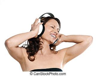 Portrait of beautiful woman enjoying music