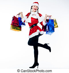 woman santa claus christmas shopping - one woman dressed as...