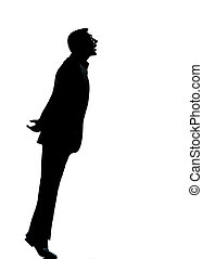 one business man silhouette tiptoe looking up