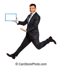 one man running jumping holding whiteboard - one caucasian...