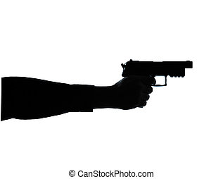 close up detail one man hand aiming gun  silhouette