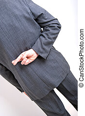 crossed fingers - A conceptial image of a business man with...