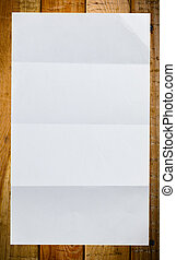 Sheet of white paper on wood