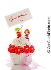 A wedding cupcake on white background as studio shot