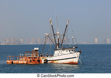 Old fishing trawler in Doha, Qatar