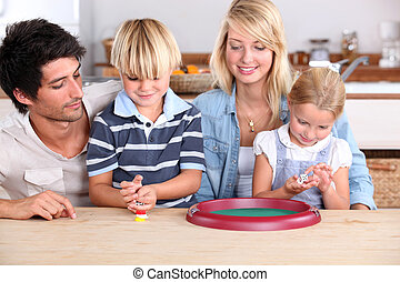 Young family playing dice