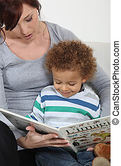 Woman and child reading a book