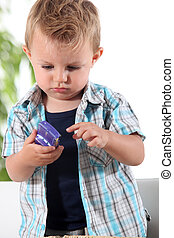 Little boy holding toy car