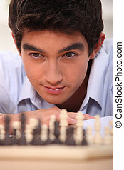 young chess player looking focused