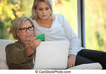 Elderly woman using a card online