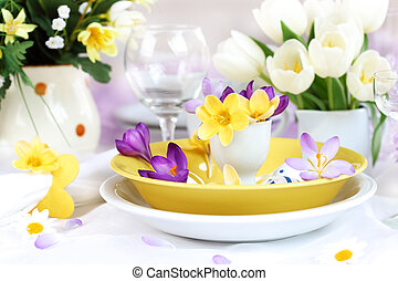 Place setting for Easter with crocuses and Easter eggs