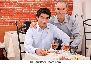 Two generations sitting in a restaurant