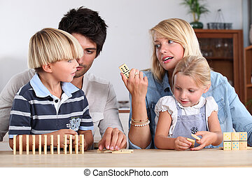 Family playing dominoes