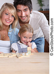 parents having fun with their little girl