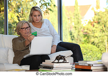Mother and daughter checking social security online