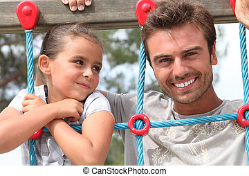 father and daughter together in the playground