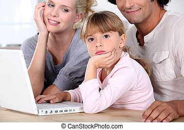 Family in front of laptop