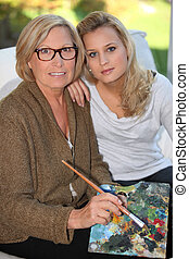 Grandmother and granddaughter painting