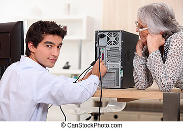 young man trying to repair computer