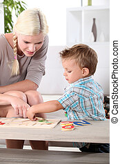 Mother and son doing a jigsaw puzzle