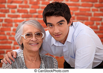 Grandson and grandmother in restaurant