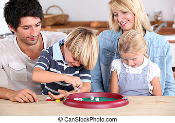 Family playing a dice game
