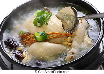 steaming samgyetang - chicken soup with ginseng, korean food