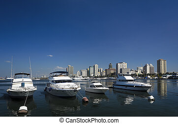 Yacht - White boats anchored in Manila Bay, Philippines