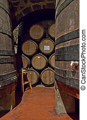 wine barrels - old cellar with big and small wine barrels