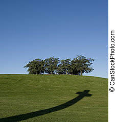 Cross shadow in the grass