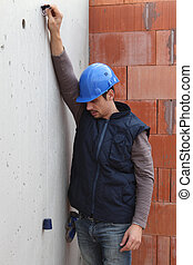 Builder with a plumb line