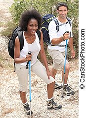 Couple hiking with sticks