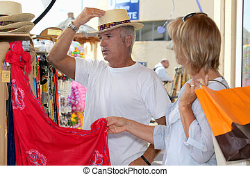 Couple shopping on vacation