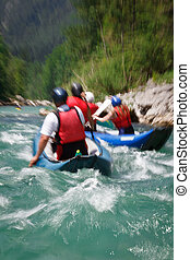 white water rafting motion blur is used to convey rapid flow...