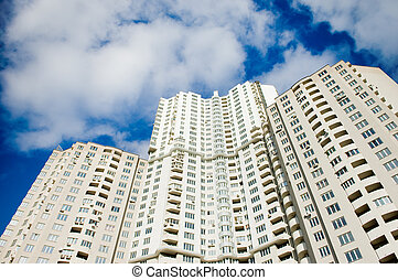 Buildings over blue sky background - Modern buildings over...