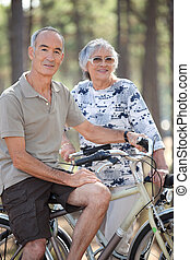 Old couple with bikes