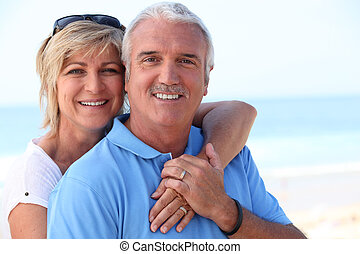 Middle-aged couple at the coast