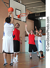Basketball player shooting