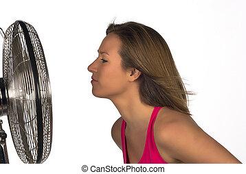 Summer - Face next to a fan, a summer concept