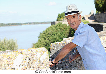 Man on the ramparts overlooking the river