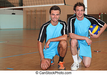 Volleyball players kneeling