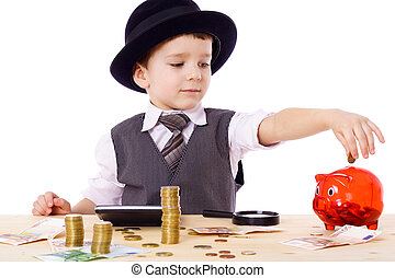 Boy at the table counts money - Little boy like a boss at...