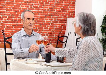 Elderly couple eating in restaurant