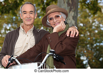 Older couple with a bicycle