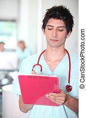 Nurse checking notes