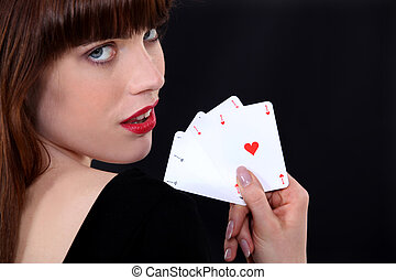 Gorgeous girl showing four aces