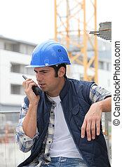 Builder on walkie talkie