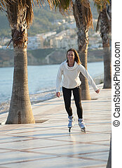 Happy skater - Woman enjoying a sunny afternoon on her...